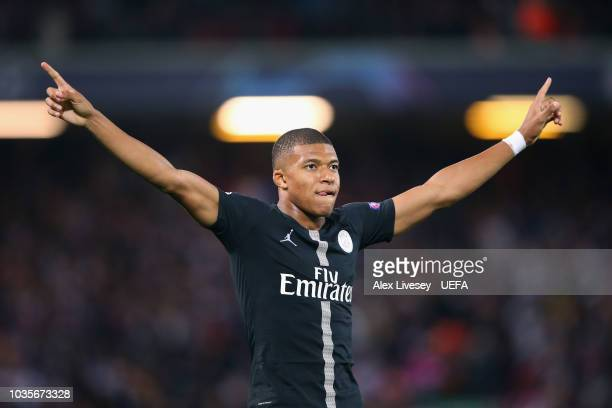 Kylian Mbappe of Paris SaintGermain celebrates after scoring their second goal during the Group C match of the UEFA Champions League between...
