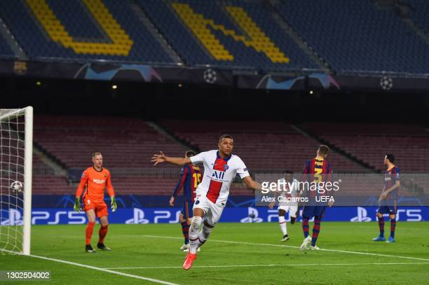 Kylian Mbappe of Paris Saint-Germain celebrates after scoring their side's first goal during the UEFA Champions League Round of 16 match between FC...