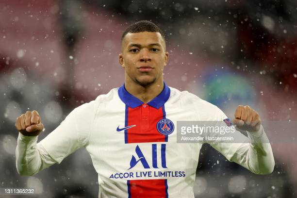 Kylian Mbappe of Paris Saint-Germain celebrates after scoring their side's first goal during the UEFA Champions League Quarter Final match between FC...
