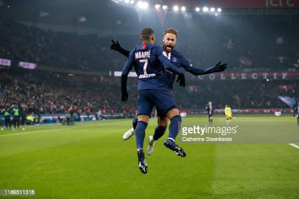 Kylian Mbappe of Paris Saint-Germain celebrates his goal with Neymar Jr of Paris Saint-Germain during the Ligue 1 match between Paris Saint-Germain...