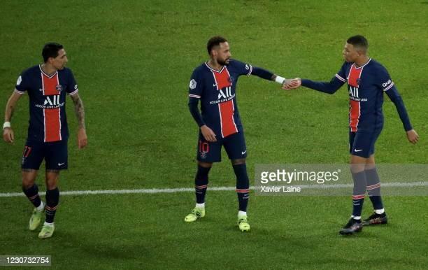 Kylian Mbappe of Paris Saint-Germain celebrates his goal with Neymar Jr and Angel Di Maria during the Ligue 1 match between Paris Saint-Germain and...