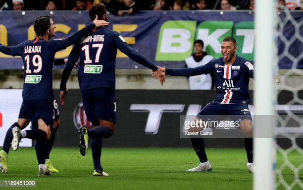 Kylian Mbappe of Paris Saint-Germain celebrates his goal with team mates during the Ligue Cup match between Le Mans FC and Paris Saint-Germain at MMA...