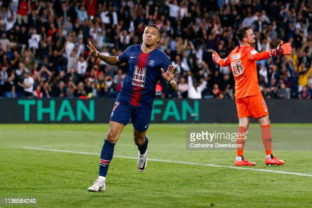 Kylian Mbappe of Paris Saint-Germain celebrates his second goal of the Ligue 1 match between Paris Saint-Germain and AS Monaco at Parc des Princes on...