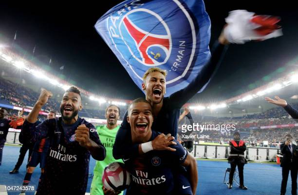 Kylian Mbappe of Paris SaintGermain celebrates the victory and his four goal with Neymar Jr after the French Ligue 1 match between Paris Saint...