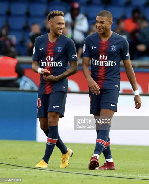 Kylian Mbappe of Paris SaintGermain celebrates the victory with Neymar Jr during the Ligue 1 match between Paris SaintGermain and SCO Angers at Parc...