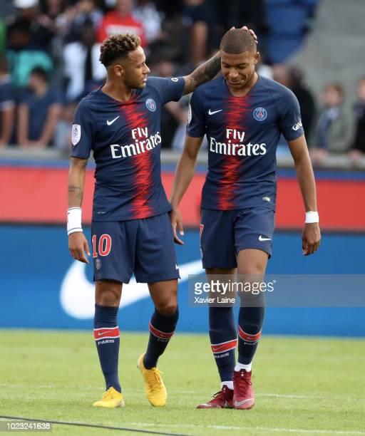 Kylian Mbappe of Paris SaintGermain celebrates the victory with Neymar Jr after the Ligue 1 match between Paris SaintGermain and SCO Angers at Parc...