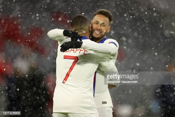 Kylian Mbappe of Paris Saint-Germain celebrates with team mate Neymar after scoring their side's first goal during the UEFA Champions League Quarter...