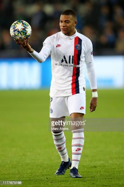 Kylian Mbappe of Paris Saint-Germain celebrates with the match ball after scoring his hat trick during the UEFA Champions League group A match...