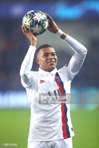 Kylian Mbappe of Paris Saint-Germain celebrates with the match ball after scoring a hatrick in his team's victory in the UEFA Champions League group...