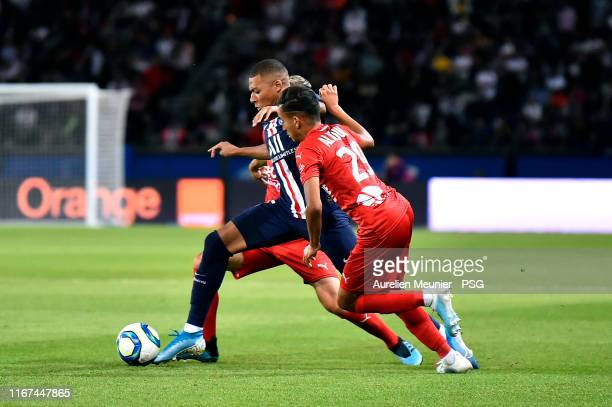 Kylian Mbappe of Paris Saint-Germain fights for the ball during the Ligue 1 match between Paris Saint-Germain and Nimes Olympique at Parc des Princes...