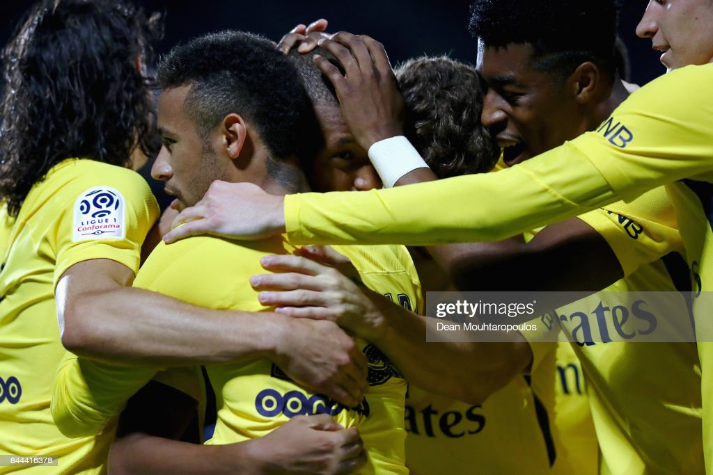 Kylian Mbappe of Paris Saint-Germain Football Club or PSG celebrates scoring his teams second goal of the game with team mates during the Ligue 1 match between Metz and Paris Saint Germain or PSG held at Stade Saint-Symphorien on September 8, 2017 in Metz, France.