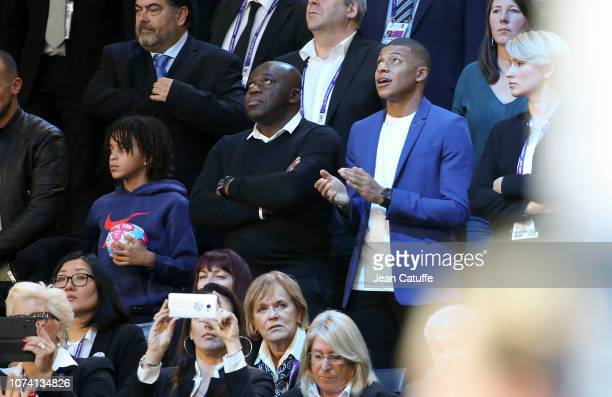 Kylian Mbappe of Paris SaintGermain his little brother Ethan Mbappe and his father Wilfried Mbappe celebrate the victory of France following the EHF...