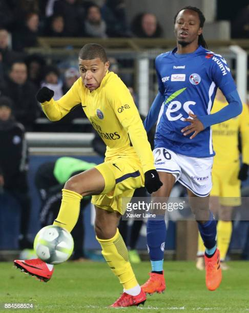 Kylian Mbappe of Paris SaintGermain in action Bakary Kone of Strasbourg during the Ligue 1 match between Strasbourg and Paris Saint Germain at La...