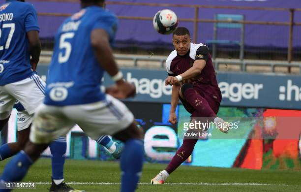 Kylian Mbappe of Paris Saint-Germain in action during the Ligue 1 match between Strasbourg and Paris at Stade de la Meinau on April 10, 2021 in...