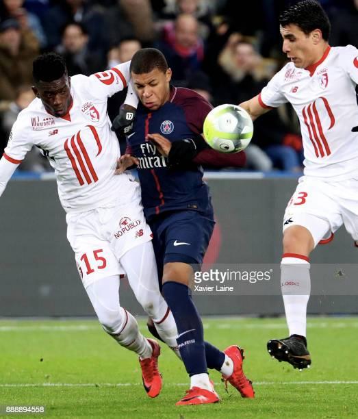 Kylian Mbappe of Paris SaintGermain in action during the Ligue 1 match between Paris Saint Germain and Lille OSC at Parc des Princes on December 9...