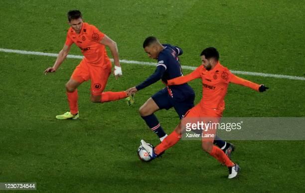 Kylian Mbappe of Paris Saint-Germain in action Teji Savanier of Montpellier HSC during the Ligue 1 match between Paris Saint-Germain and Montpellier...