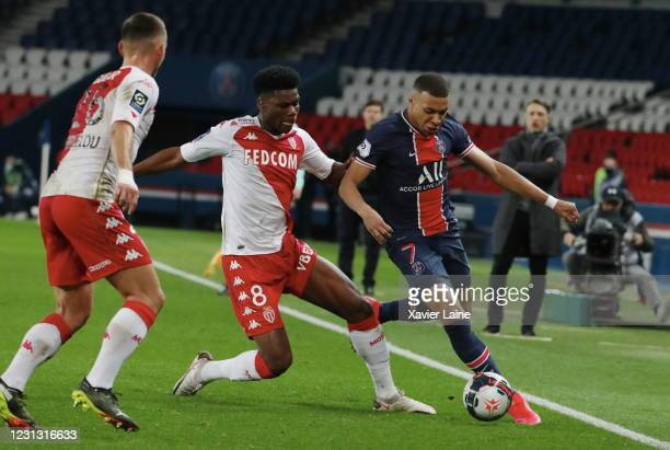 Kylian Mbappe of Paris Saint-Germain in action with Axel Disasi of AS Monaco during the Ligue 1 soccer match between Paris Saint-Germain and AS...