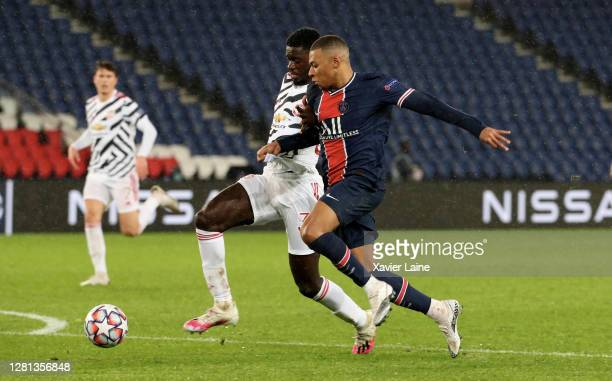 Kylian Mbappe of Paris SaintGermain in action with Axel Tuanzebe of Manchester United during the UEFA Champions League Group H stage match between...