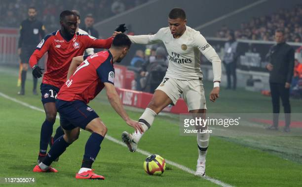 Kylian Mbappe of Paris SaintGermain in action with Jonathan Ikone of Lille LOSC during the Ligue 1 match between Lille OSC and Paris SaintGermain at...