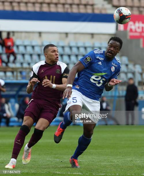 Kylian Mbappe of Paris Saint-Germain in action with Lamine Kone during the Ligue 1 match between Strasbourg and Paris at Stade de la Meinau on April...