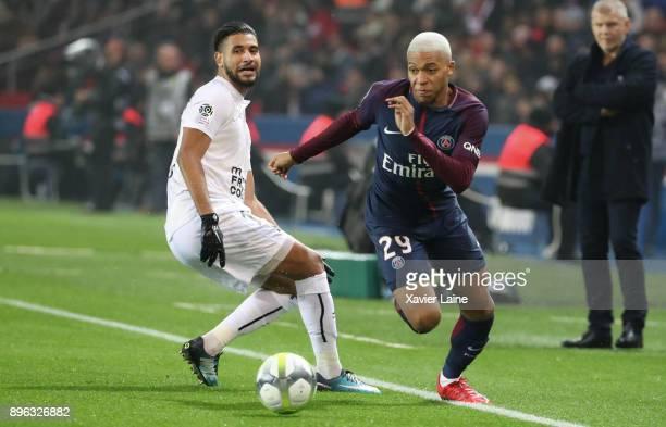 Kylian Mbappe of Paris SaintGermain in action with Youssef Ait Bennasser of SM Caen during the Ligue 1 match between Paris Saint Germain and SM Caen...