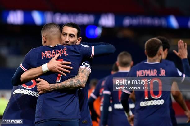 Kylian Mbappe of Paris Saint-Germain is congratulated by teammate Angel Di Maria after scoring during the Ligue 1 match between Paris Saint-Germain...