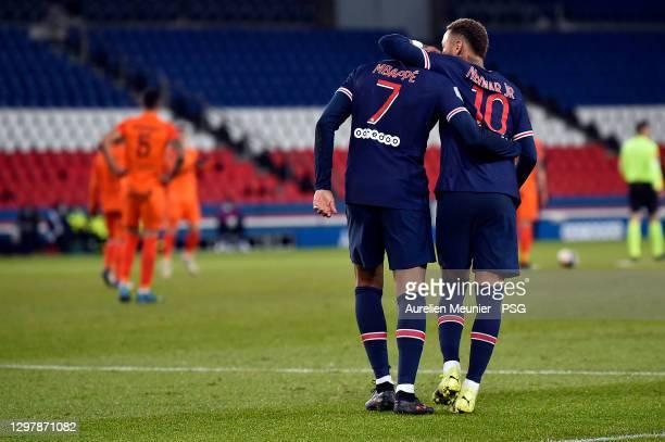 Kylian Mbappe of Paris Saint-Germain is congratulated by teammate Neymar Jr after scoring during the Ligue 1 match between Paris Saint-Germain and...