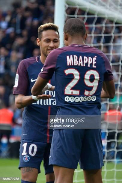 Kylian Mbappe of Paris SaintGermain is congratulated by teammate Neymar Jr after scoring during the Ligue 1 match between Paris Saint Germain and FC...