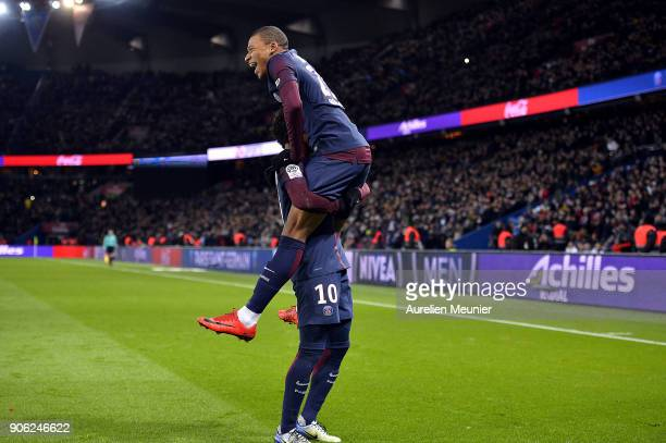 Kylian Mbappe of Paris SaintGermain is congratulated by teAMMATE Neymar Jr after scoring during the Ligue 1 match between Paris Saint Germain and...