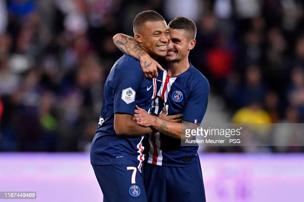Kylian Mbappe of Paris Saint-Germain is congratulated by teammate Marco Verratti after scoring during the Ligue 1 match between Paris Saint-Germain...