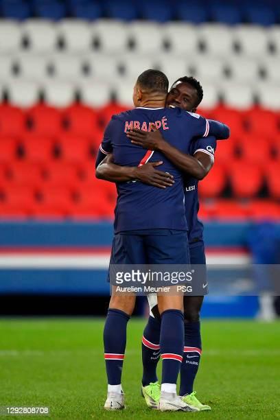 Kylian Mbappe of Paris Saint-Germain is congratulated by teammate Idrissa Gueye after scoring during the Ligue 1 match between Paris Saint-Germain...