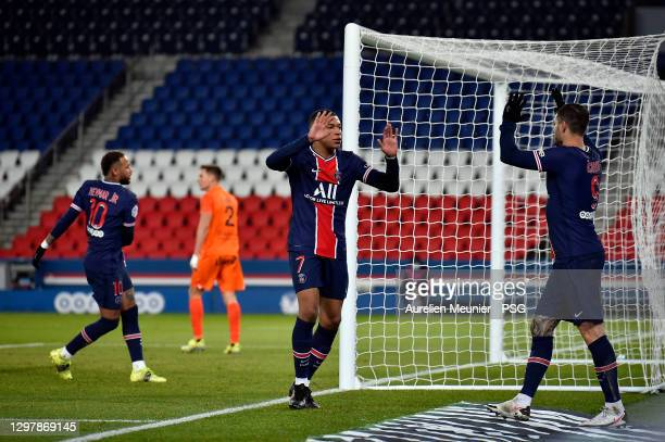 Kylian Mbappe of Paris Saint-Germain is congratulated by teammate Mauro Icardi after scoring during the Ligue 1 match between Paris Saint-Germain and...