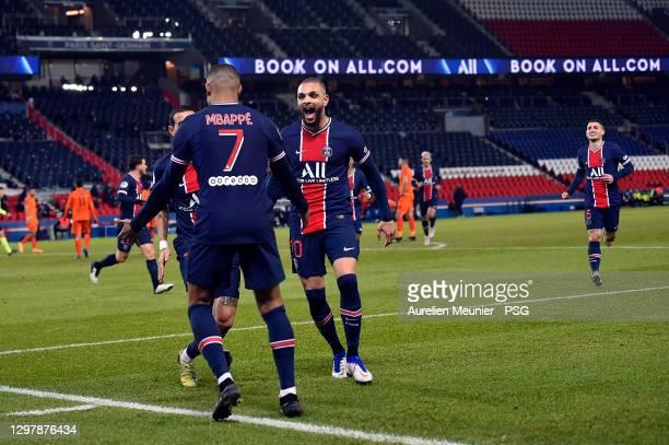 Kylian Mbappe of Paris Saint-Germain is congratulated by teammate Layvin Kurzawa after scoring during the Ligue 1 match between Paris Saint-Germain...
