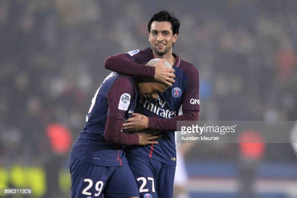 Kylian Mbappe of Paris SaintGermain is congratulated by teammate Javier Pastore after scoring during the Ligue 1 match between Paris Saint Germain...