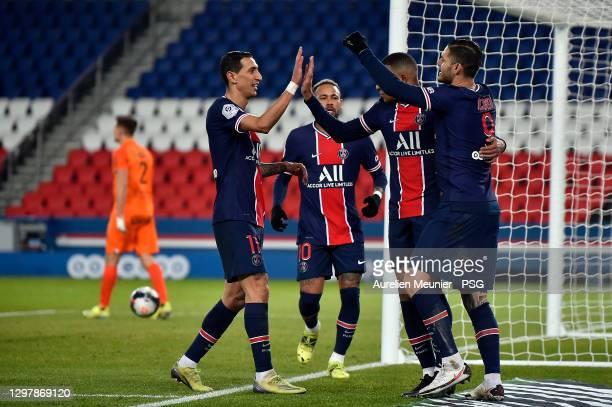 Kylian Mbappe of Paris Saint-Germain is congratulated by teammates Angel Di Maria, Mauro Icardi and Neymar Jr after scoring during the Ligue 1 match...