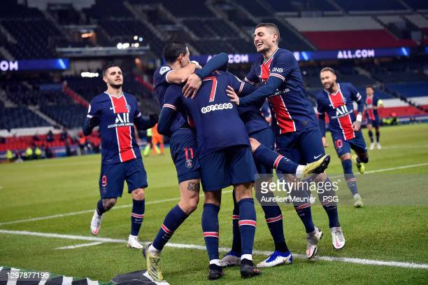 Kylian Mbappe of Paris Saint-Germain is congratulated by teammates Angel Di Maria and Marco Verratti after scoring during the Ligue 1 match between...