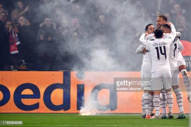 Kylian Mbappe of Paris SaintGermain is congratulated by teammates Neymar Jr Pablo Sarabia Juan Bernat after scoring during the UEFA Champions League...