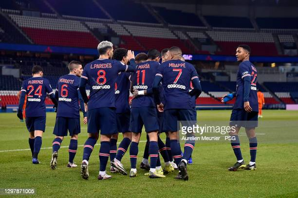 Kylian Mbappe of Paris Saint-Germain is congratulated by teammates after scoring during the Ligue 1 match between Paris Saint-Germain and Montpellier...