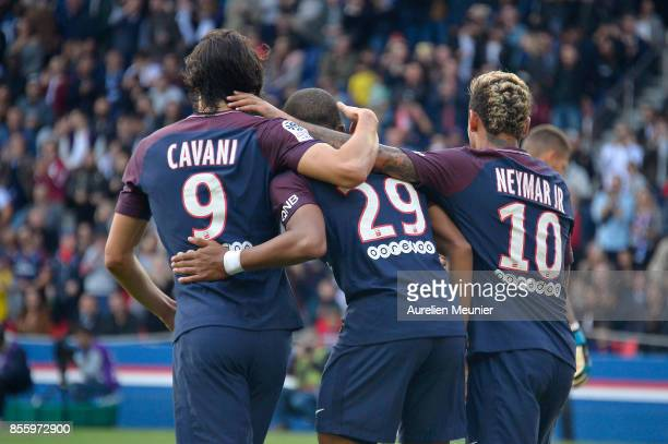 Kylian Mbappe of Paris SaintGermain is congratulated by teammates Edinson Cavani and Neymar Jr after scoring during the Ligue 1 match between Paris...