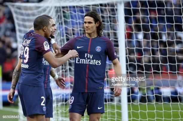 Kylian Mbappe of Paris SaintGermain is congratulated by teammates Edinson Cavani and Layvin Kurzawa after scoring during the Ligue 1 match between...