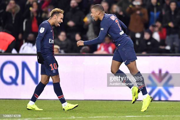 Kylian Mbappe of Paris SaintGermain is congratulated ny teammate Neymar Jr after scoring during the ligue 1 match between Paris SaintGermain and...