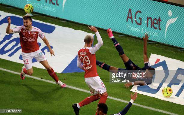 Kylian Mbappe of Paris Saint-Germain is slash during the Ligue 1 match between Stade Reims and Paris Saint-Germain at Stade Auguste Delaune on...