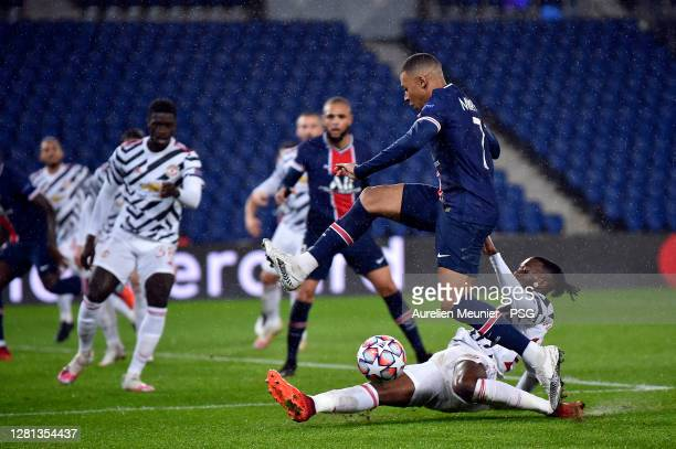 Kylian Mbappe of Paris Saint-Germain is tackled by Aaron Wan Bissaka of Manchester United during the UEFA Champions League Group H stage match...
