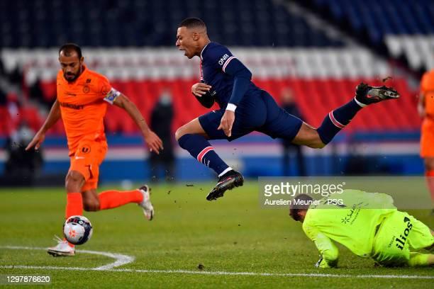 Kylian Mbappe of Paris Saint-Germain is tackled during the Ligue 1 match between Paris Saint-Germain and Montpellier HSC at Parc des Princes on...