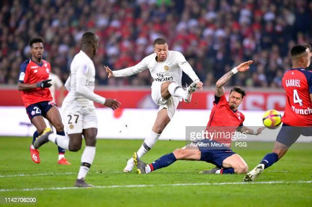Kylian Mbappe of Paris SaintGermain kicks the ball during the Ligue 1 match between Paris SaintGermain and Lille OSC at Stade Pierre Mauroy on April...