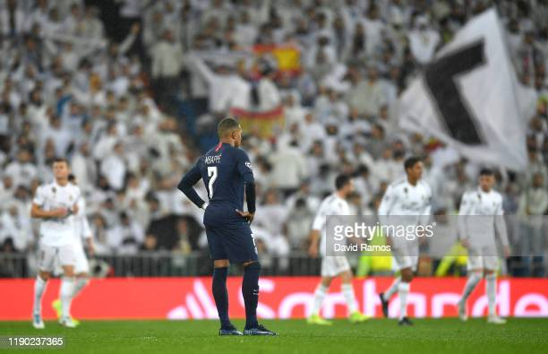 Kylian Mbappe of Paris Saint-Germain looks dejected after Karim Benzema of Real Madrid scores his team's first goal during the UEFA Champions League...