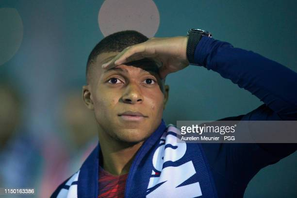 Kylian Mbappe of Paris Saint-Germain looks on after the champion trophy ceremony after the Ligue 1 match between Paris Saint-Germain and Dijon FCO at...