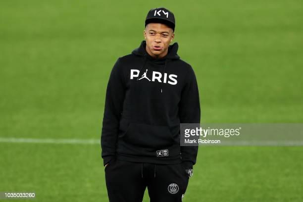 Kylian Mbappe of Paris SaintGermain looks on as Paris SaintGermain walks the pitch on the eve of their UEFA Champions League Match against Liverpool...