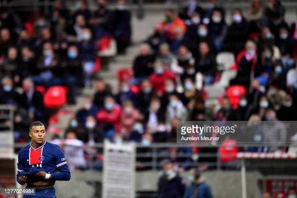 Kylian Mbappe of Paris Saint-Germain looks on during the Ligue 1 match between Stade Reims and Paris Saint-Germain at Stade Auguste Delaune on...