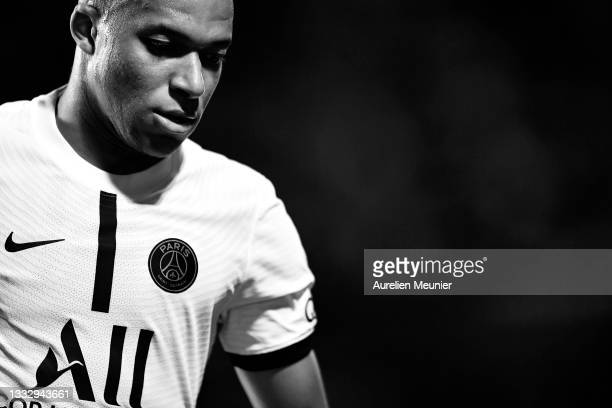 Kylian Mbappe of Paris Saint-Germain looks on during the Ligue 1 football match between Troyes and Paris at Stade de l'Aube on August 07, 2021 in...